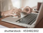 female hands typing on laptop...   Shutterstock . vector #453482302