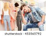 boyfriend is bored in shop | Shutterstock . vector #453565792