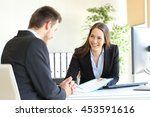dealer attending to a customer... | Shutterstock . vector #453591616