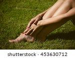 woman barefoot legs on grass... | Shutterstock . vector #453630712