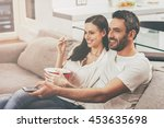 enjoying favorite show together.... | Shutterstock . vector #453635698