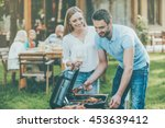 barbeque time. happy young... | Shutterstock . vector #453639412