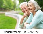 mature couple in spring park | Shutterstock . vector #453649222