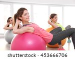 young women doing exercise with ... | Shutterstock . vector #453666706