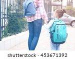 parent taking child to school | Shutterstock . vector #453671392