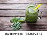 spinach smoothie in jar with... | Shutterstock . vector #453692548