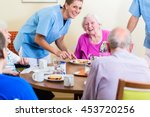 group of seniors having food in ... | Shutterstock . vector #453720256
