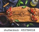 tomato and basil bruschetta... | Shutterstock . vector #453784018