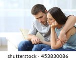 sad couple comforting each... | Shutterstock . vector #453830086
