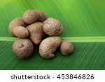 Small photo of air potato on banana leaf focusing at front.