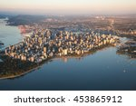Stock photo aerial view of stanley park and downtown vancouver bc canada during a hazy sunny sunset 453865912