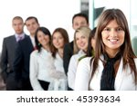 successful business people at the office smiling - stock photo