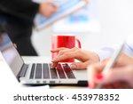 hand of businesswoman press... | Shutterstock . vector #453978352