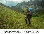 man climbs a mountain at the...   Shutterstock . vector #453989122