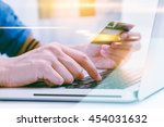 hand holding credit card with... | Shutterstock . vector #454031632