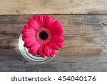 Pink Gerbera On Wooden Table
