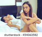 attractive woman grieves while... | Shutterstock . vector #454063582