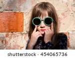 Little Girl In Sunglasses At...