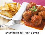 meats ball on tomato sauce with salad - stock photo