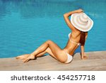 portrait of beautiful tanned... | Shutterstock . vector #454257718