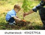 cute baby boy planting tree...   Shutterstock . vector #454257916