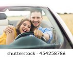 couple enjoying a drive in a... | Shutterstock . vector #454258786