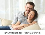 happy couple sitting in a... | Shutterstock . vector #454334446