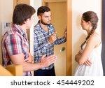 Angry Male Neighbor Standing A...
