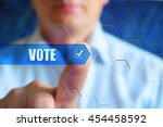 Small photo of Vote button. Person touch text button Vote with check box. Election, voting, choice concept.