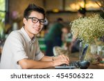 handsome businessman working...   Shutterstock . vector #454506322