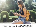 hipster girl with backpack and... | Shutterstock . vector #454532386