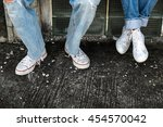 lovers couple with sneaker... | Shutterstock . vector #454570042