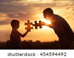 father and son playing at the... | Shutterstock . vector #454594492
