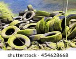 Old Tires Covered In Green...
