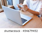 a young woman working with...   Shutterstock . vector #454679452