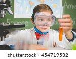 schoolgirl doing a chemical... | Shutterstock . vector #454719532