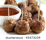 Meatball appetizers, with a dipping sauce. - stock photo