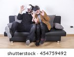 guy playing with vr glasses... | Shutterstock . vector #454759492