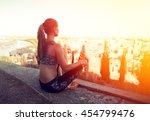 young woman athlete relaxing on ... | Shutterstock . vector #454799476