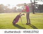 side view of woman putting golf ... | Shutterstock . vector #454813702