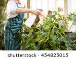 Midsection Of Female Gardener...