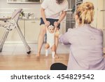 the first baby steps. a happy...   Shutterstock . vector #454829542