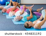 instructor performing yoga with ... | Shutterstock . vector #454831192