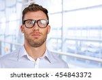 nerd businessman in glasses | Shutterstock . vector #454843372