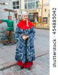 Small photo of Tallinn, Estonia - October 18, 2015: The girl in the national costume about a famous local restaurant Olde Hansa in Tallinn.