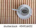 coffee beans and a white cup on ... | Shutterstock . vector #454916452