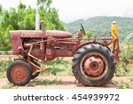 The Old Tractor In The Field O...