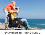 disabled father looking through ... | Shutterstock . vector #454946512