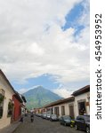 Small photo of 04/07/16. Editorial. Colonial buildings in Antigua and volcano of Agua, Guatemala