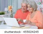 happy senior couple with laptop   Shutterstock . vector #455024245